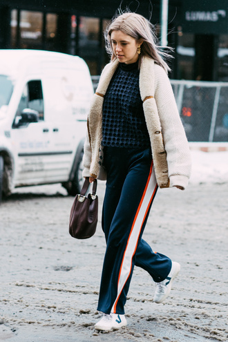 jacket tumblr nyfw 2017 fashion week 2017 fashion week nude jacket shearling jacket shearling sweater blue sweater pants blue pants navy side stripe pants sneakers white sneakers bag brown bag