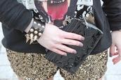 shorts,Sequin shorts,sequins,gold sequins,bracelets,studs,studded,pouch,nail polish,sweatshirt