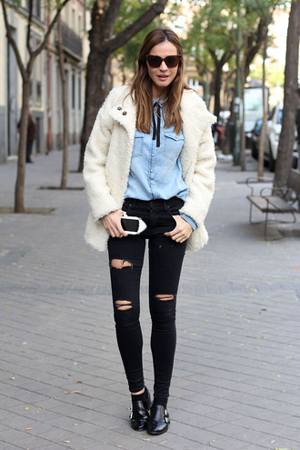 lady addict blogger coat shirt shoes sunglasses fuzzy coat denim shirt ripped jeans black jeans black ripped jeans jeans bag white fluffy coat