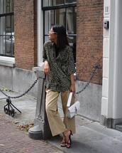 top,animal print,mules,wide-leg pants,sunglasses,earrings,bag