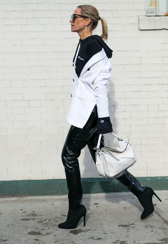 pants nyfw 2017 fashion week 2017 fashion week streetstyle black pants black leather pants leather pants vinyl black vinyl pants boots black boots high heels boots bag white bag loewe bag hoodie black hoodie blazer white blazer