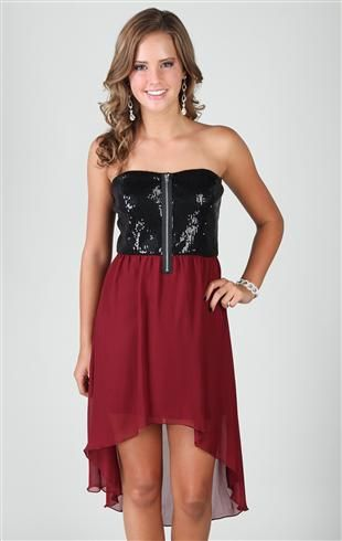 Strapless sequin body with exposed zipper front and a high low hem