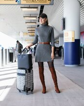 memorandum,blogger,dress,belt,shoes,jewels,bag,turtleneck dress,sweater dress,grey dress,airport fashion,thigh high boots,brown boots,tote bag,suitcase