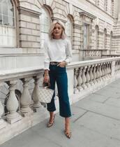 bag,handbag,net,tote bag,cropped jeans,high waisted jeans,belt,white blouse,leopard print,pumps