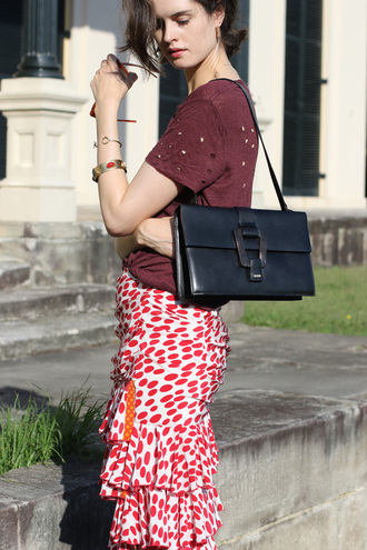 by chill blogger ripped tshirt shoulder bag black leather bag polka dots ruffle printed skirt silk skirt