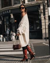 bag,baggy pants,yves saint laurent,brown leather boots,heel boots,oversized cardigan,white sweater,cable knit,black leggings,black top