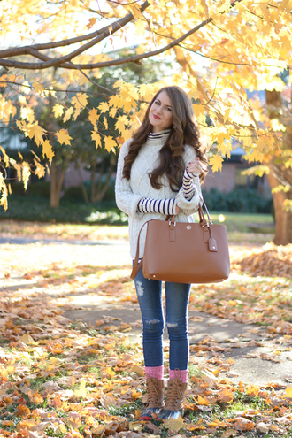 southern curls and pearls blogger bag socks jewels make-up striped sweater ripped jeans knitted sweater sunglasses white cable knit sweater cable knit curly hair long hair fall outfits blue jeans