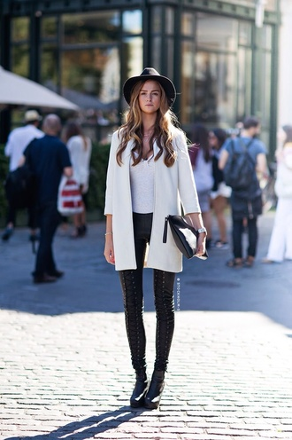 coat black feodora white coat black leather pants white top white dress coat white winter coat winter outfits occasion long coat streetstyle pants lace up pants black pants top pouch black pouch hat black hat felt hat boots black boots