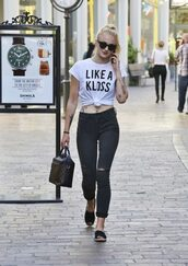 top,jeans,sophie turner,t-shirt,tie-front top,tumblr,celebrity style,celebrity,cuffed jeans,black jeans,black ripped jeans,ripped jeans,white t-shirt,quote on it,bag,louis vuitton,louis vuitton bag,espadrilles,sunglasses,black sunglasses