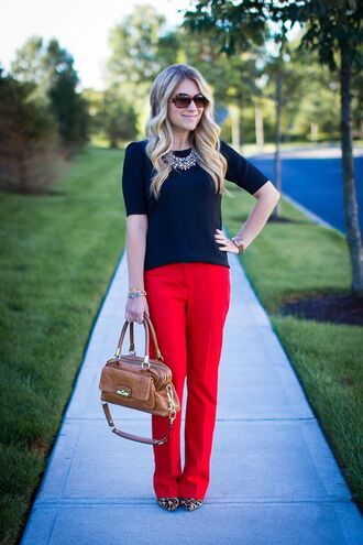 pants red pants top black top bag brown bag necklace statement necklace sunglasses tortoise shell sunglasses pumps animal print high heels office outfits