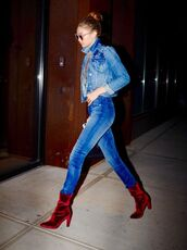 shoes,velvet boots,boots,red boots,high heels boots,velvet,jeans,denim,blue jeans,skinny jeans,gigi hadid,gigi hadid style,celebrity style,celebrity,denim jacket,blue jacket,jacket,sunglasses