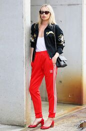 pants,adidas,adidas pants,red pants,athleisure,shoes,mid heel pumps,red heels,red shoes,top,white top,jacket,bomber jacket,embellished,embellished jacket,bag,black bag,sunglasses,black sunglasses,side stripe pants,white tank top,black bomber jacket,red sweatpants,red square heels,blogger