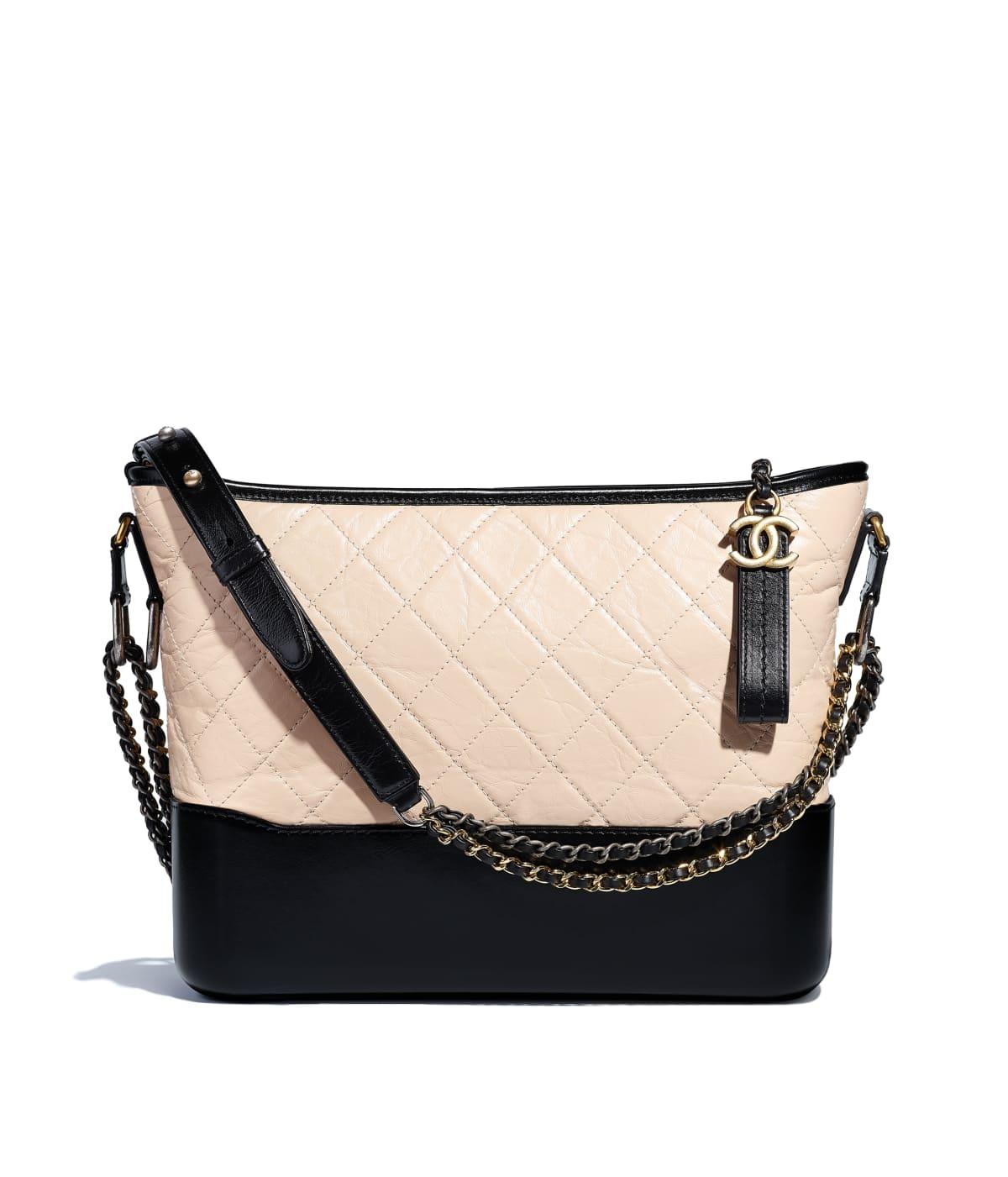 e3500e307240 CHANEL'S GABRIELLE Hobo Bag, aged calfskin, smooth calfskin, silver-tone &  gold-tone metal, beige & black ...