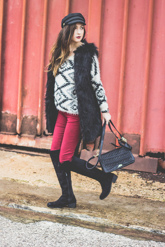 shoes and basics blogger pants aztec aztec sweater faux fur vest winter outfits black boots black bag cap