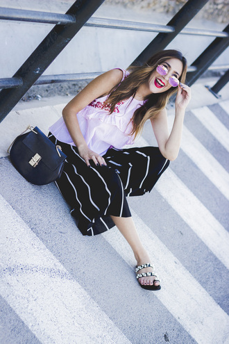 shoes and basics blogger top pants bag shoes sunglasses sandals black pants striped pants summer outfits