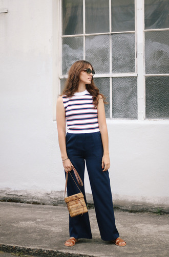 the mop top blogger top pants sunglasses bag shoes striped top sleeveless top wide-leg pants blue pants basket bag beige bag slide shoes hermes hermes shoes summer outfits
