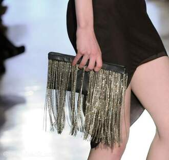 bag clutch fringed bag model runway catwalk gold black black bag black clutch gold bag gold clutch black and gold bag black and gold clutch