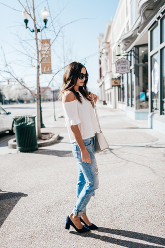 blouse tumblr white blouse cut-out cut-out shoulder top denim jeans blue jeans ripped jeans bag white bag pumps pointed toe pumps suede suede heels blue shoes sunglasses spring outfits