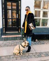 coat,black coat,sweatshirt,orange sweatshirt,jeans,blue jeans,shoes,black shoes,sweater