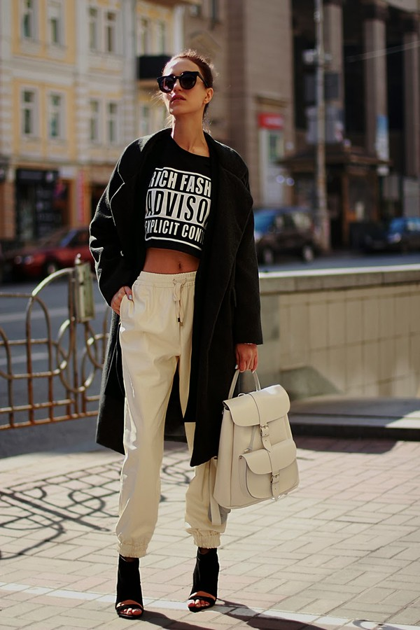 tina sizonova pants coat sweater shoes jewels bag black boots crop tops slogan crop top grafea white backpack white leather backpack leather backpack sweatpants white sweatpants peep toe heels peep toe boots black crop top black coat black long coat black sunglasses oversized sunglasses
