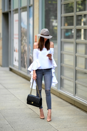 vogue haus blogger top jeans shoes bag hat jewels chanel chanel bag off the shoulder top bell sleeves pumps high heel pumps nude heels skinny jeans felt hat tumblr off the shoulder white top long sleeves ruffle denim blue jeans pointed toe pumps