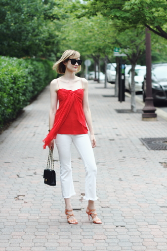 jeans cropped bootcut white jeans white jeans cropped bootcut jeans cropped jeans red top top tube top bag black bag sandals sandal heels spring outfits sunglasses black sunglasses cat eye