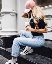 hat,pink baseball hat,cap,baseball cap,t-shirt,black t-shirt,denim,jeans,blue jeans,sneakers,adidas,adidas shoes,adidas superstars