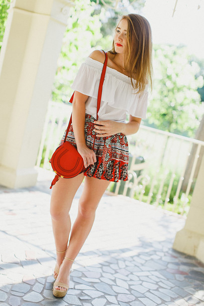 a lonestar state of southern blogger shirt top shorts shoes bag make-up off the shoulder white top mini skirt red bag ruffled top wedges red mini skirt white off shoulder top off the shoulder top shoulder bag sandals sandal heels high heel sandals nude sandals ankle strap heels