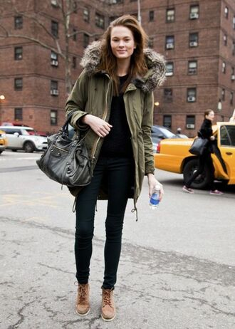 coat green coat black sweater black jeans brow boots blogger