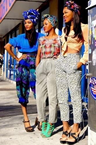 chic african print modern style purple blue turban hairwrap baggy pants capri pants 80s style printed pants blouse shoes black girls killin it