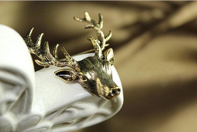 Vintage long horn deer brooch