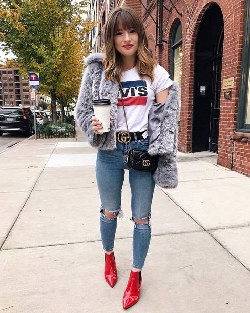 jacket tumblr grey jacket fur jacket faux fur jacket t-shirt logo tee denim jeans blue jeans ripped jeans skinny jeans boots red boots ankle boots crossbody bag