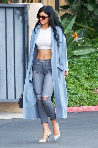 white top crop tops grey jeans sunglasses white heels kylie jenner coat blue baby blue duster coat trench coat oversized blue coat ripped jeans keeping up with the kardashians winter coat jeans high waisted pants grey