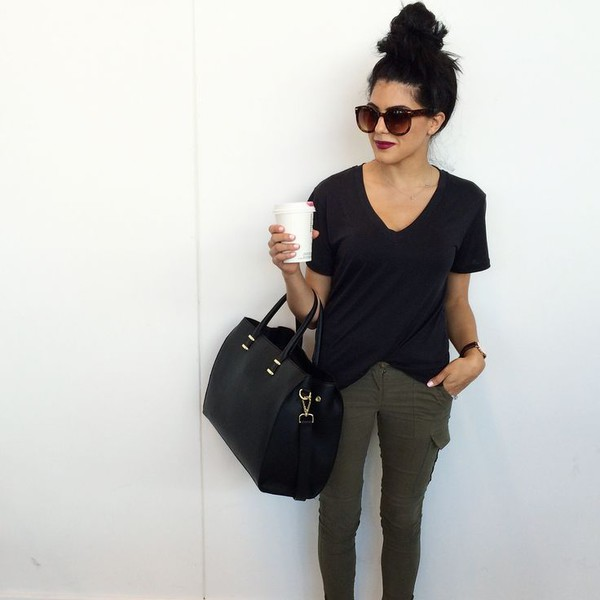 jeans olive green coffee v neck bag hair bun sun sunglasses t-shirt top