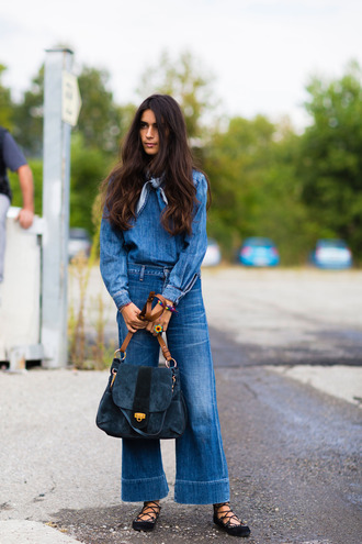 top fashion week street style fashion week 2016 fashion week milan fashion week 2016 denim top blue top long sleeves denim jeans blue jeans flare jeans bag denim bag blue bag streetstyle pointed flats flats lace up flats all denim outfit all blue