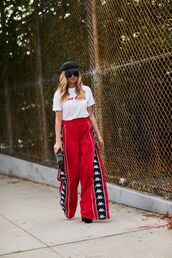 pants,red pantsw,red pants,wide-leg pants,top,white top,hat,sunglasses,shoes
