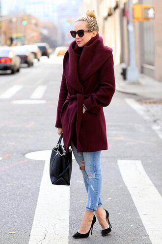 coat burgundy coat ripped jeans black stilettos black bag blogger sunglasses