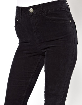 ASOS | ASOS Ridley Supersoft Ultra Skinny Jeans in Washed Black Cord with Ripped Knees at ASOS