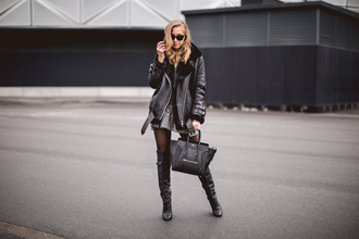 kenza blogger sunglasses shearling jacket thigh high boots celine