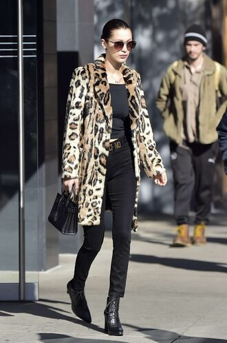 coat animal print fall coat pants ankle boots top bella hadid model off-duty streetstyle leopard print fur coat fur leopard print winter coat black top black jeans logo belt belt celebrity style celebrity