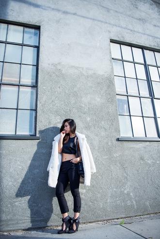 neon blush blogger crop tops black heels fuzzy coat cropped pants coat top pants shoes white fluffy coat black crop top black top black pants black bag high heels