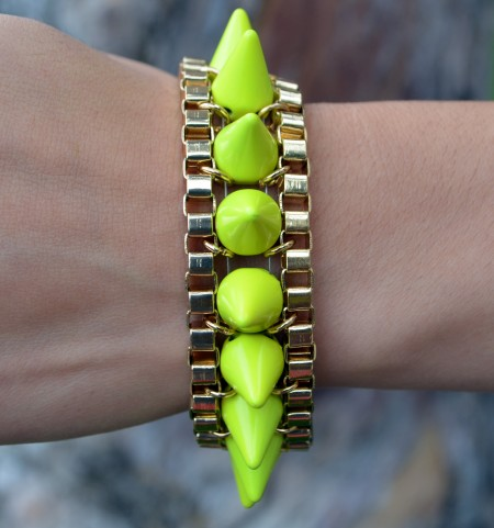 Gold bracelet with neon yellow spikes