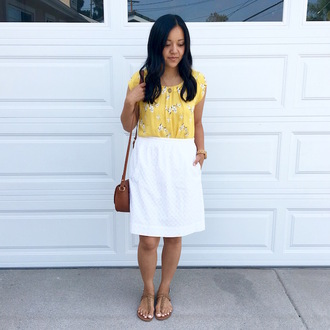 puttingmetogether blogger bag shoes jewels yellow top floral top white skirt mini skirt flats shoulder bag