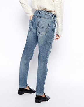 ASOS | ASOS Brady Low Rise Slim Boyfriend Jeans in Mid Wash with Extreme Rips at ASOS