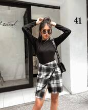 skirt,mini skirt,checkered,asymmetrical skirt,wrap skirt,black blouse,sunglasses,earrings,shoulder bag