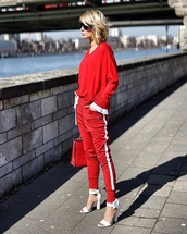 shoes,sandals,white sandals,sweatpants,red pants,sweater,red sweater,sunglasses,athleisure