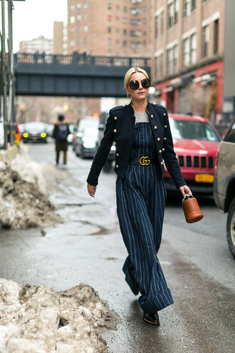 jumpsuit nyfw 2017 fashion week 2017 wide-leg pants stripes striped pants blue jumpsuit belt fashion week streetstyle jacket black jacket military style top grey top bag brown bag sunglasses oversized sunglasses logo belt gucci gucci belt