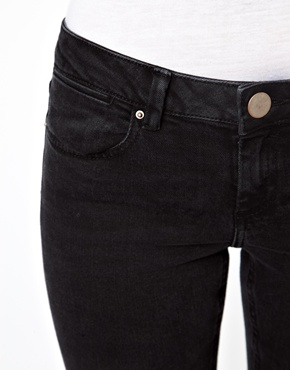 ASOS | ASOS Whitby Low Rise Skinny Ankle Grazer Jeans in Washed Black with Ripped Knee at ASOS