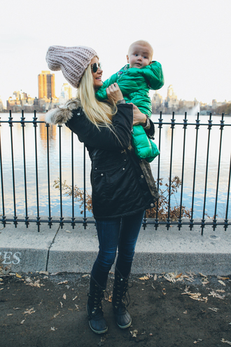 barefoot blonde blogger jeans kids fashion green winter coat knitted beanie