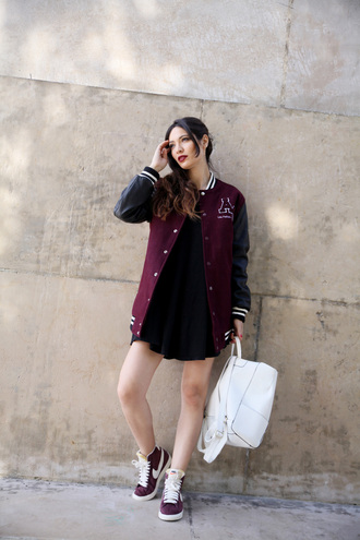 la couleur du moment blogger baseball jacket nike sneakers leather backpack back to school white backpack black dress mini dress sneakers nike nike shoes
